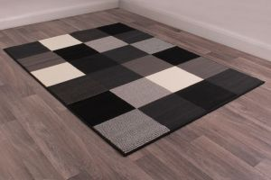Pixels Rugs in Black by Rugstyle