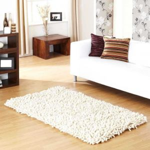 Rocky Handwoven Shaggy Wool Rugs in Ivory