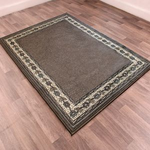 Valencia Plain Bordered Rugs in Chocolate Brown